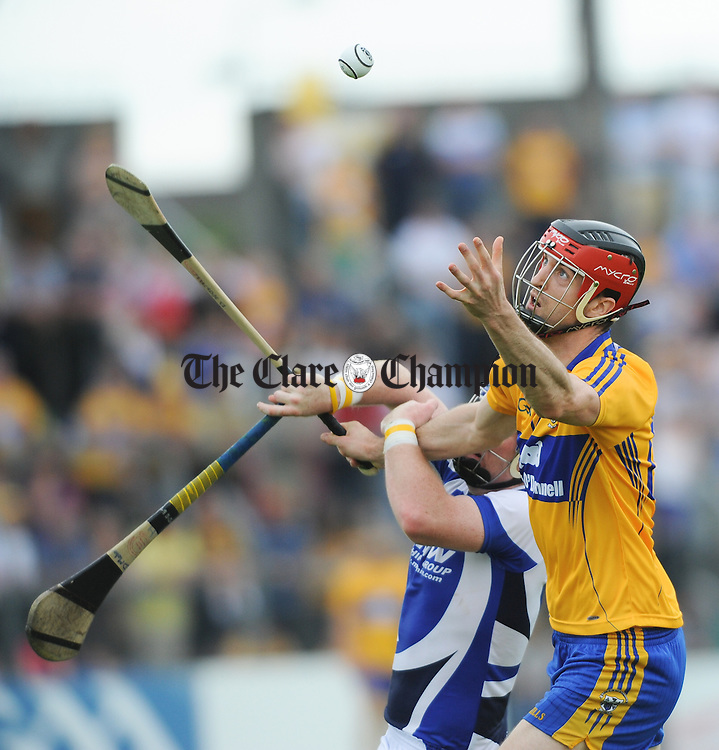 Darach Honan of Clare in action against Darren Maher of Laois during their All-Ireland hurling qualifier at Cusack park. Photograph by John Kelly.