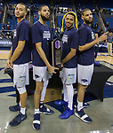Nevada's Kendall Stephens, Caleb Martin, Hallice Cooke and Cody Martin (left to right) celebrate with their trophy after defeating Colorado State for the MW championship in an NCAA college basketball game in Reno, Nev., Sunday, Feb. 25, 2018. (AP Photo/Tom R. Smedes)
