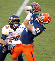 Virginia Cavaliers tight end Jake McGee (83) makes a 4th quarter touchdown catch in front of Maryland Terrapins defensive back Anthony Nixon (20) Saturday at Scott Stadium in Charlottesville, VA. Maryland defeated Virginia 27-20.