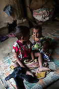 Muniya plays with her older brother in their hut in Shivpur Hariyya village in Raxaul district of Bihar. Muniya's mother Ravina Khatoon died few days after giving birth to Muniya.