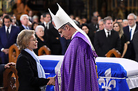 Widow Chantal Renaud receives condolences from  Archbishop Lepine at the funeral of former Quebec premier Bernard Landry at Notre-Dame Basilica  in Montreal on Tuesday, November 13, 2018. THE CANADIAN PRESS/Paul Chiasson