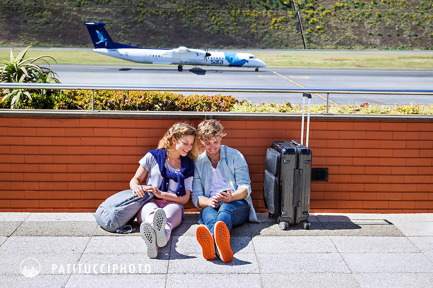 A couple traveling to Madeira Island at the airport