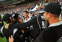 Ian Butler (centre)  and the rest of the Black Caps celebrate during 2nd Twenty20 cricket match match between New Zealand Black Caps and West Indies at Westpac Stadium, Wellington, New Zealand on Friday, 27 February 2009. Photo: Dave Lintott / lintottphoto.co.nz