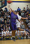 Spanish Springs Cougars Marcus Loadholt is fouled by Reed Raiders Matthew Williams in their basketball game played on Friday night, February 10, 2017 at Reed High School in Sparks, Nevada.