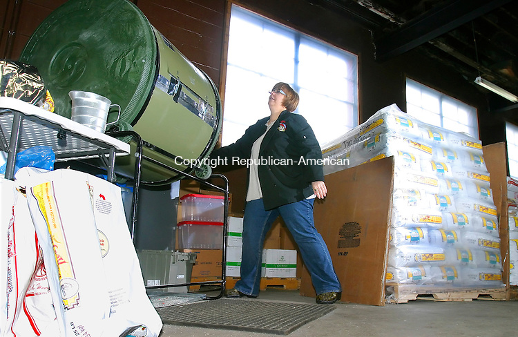 TORRINGTON CT. 15 January 2008-011508SV03--Holly DiMauro of Torrington mixes oats in her warehouse in Torrington Tuesday. DiMauro has started her own line of natural oatmeal called Holly&rsquo;s Oatmeal.<br /> Steven Valenti Republican-American