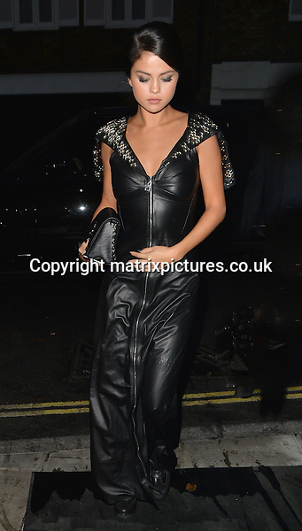 NON EXCLUSIVE PICTURE: PALACE LEE / MATRIXPICTURES.CO.UK<br /> PLEASE CREDIT ALL USES<br /> <br /> WORLD RIGHTS<br /> <br /> American actress and singer Selena Gomez is pictured visiting Loulou's restaurant in Mayfair, London. <br /> <br /> The 23 year old looks stylish wearing a long black zip up dress paired with chunky heeled boots.<br /> <br /> SEPTEMBER 20th 2015<br /> <br /> REF: LTN 152924