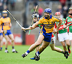 Caimin Morey of Sixmilebridge in action against James Corry of  Clooney-Quin during their senior county final at Cusack Park. Photograph by John Kelly.