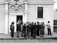 Field laborers of Japanese ancestry from a large delta ranch have assembled at WCCA Control Station to receive instructions for evacuation in three days under Civilian Exclusion Order No. 24.  Byron, CA, April 28, 1942.   Dorothea Lange. (WRA)<br /> NARA FILE #:  210-G-2C-455<br /> WAR & CONFLICT #:  774