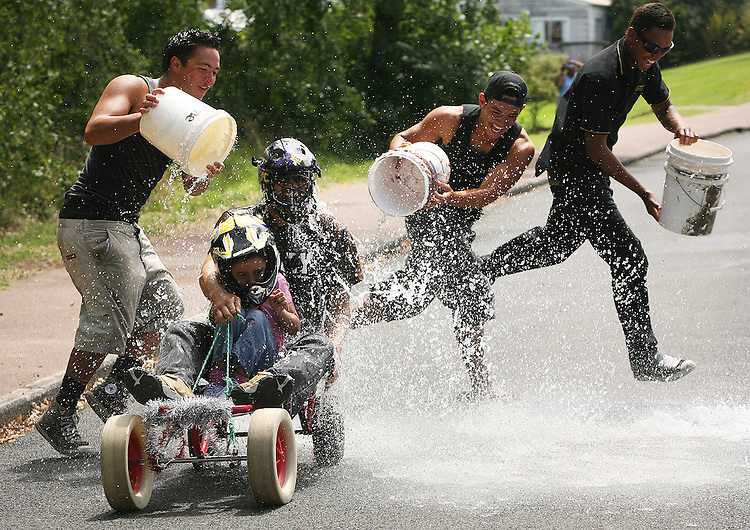Mates Daley Makoare, his cousin Quentin and Koia Waitere gave Graham Tipene and his daughter Mahaki Tipene, 5, a finishing line soaking during the Waitangi Day Trolley Derby, Auckland. 6Feb07. Photo James Madelin