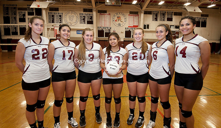 TORRINGTON,  CT-111716JS06- Torrington High School senior volleyball players, from left, Sara Bardwell; Jayleen Colon; Courtney Cappabianca; Gabriella Ballesteros; Ali Bubois; Carissa Carbone and Jolie Fox pose for a photo following practice Thursday at the school. Torrington will play Seymour in the Class M Finals on Saturday. <br /> Jim Shannon Republican American