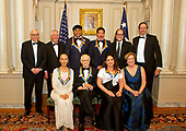 The five recipients of the 40th Annual Kennedy Center Honors pose for a group photo following a dinner hosted by United States Secretary of State Rex Tillerson in their honor at the US Department of State in Washington, D.C. on Saturday, December 2, 2017.  From left to right back row: David M. Rubenstein, Chairman, John F. Kennedy Center for the Performing Arts, US Secretary of State Rex Tillerson, LL Cool J, Lionel Richie, Glenn Weiss, and Ricky Kirshner, Executive Producers with White Cherry.  Front row, left to right: Carmen de Lavallade, Norman Lear, Gloria Estefan and Deborah F. Rutter, President of the John F. Kennedy Center for the Performing Arts.  The 2017 honorees are: American dancer and choreographer Carmen de Lavallade; Cuban American singer-songwriter and actress Gloria Estefan; American hip hop artist and entertainment icon LL COOL J; American television writer and producer Norman Lear; and American musician and record producer Lionel Richie.  <br /> Credit: Ron Sachs / Pool via CNP