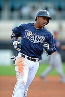Tampa Bay Rays shortstop Yunel Escobar #11 during a Grapefruit League Spring Training game against the Boston Red Sox at Charlotte County Sports Park on February 25, 2013 in Port Charlotte, Florida.  Tampa Bay defeated Boston 6-3.  (Mike Janes/Four Seam Images)