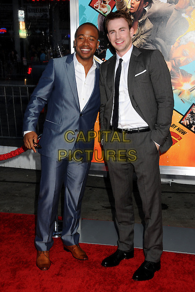 "COLUMBUS SHORT & CHRIS EVANS .""The Losers"" Los Angeles Premiere held at Grauman's Chinese Theatre, Hollywood, California, USA, .20th April 2010..full length blue suit white shirt grey gray brown shoes black tie hand in pocket .CAP/ADM/BP.©Byron Purvis/AdMedia/Capital Pictures."