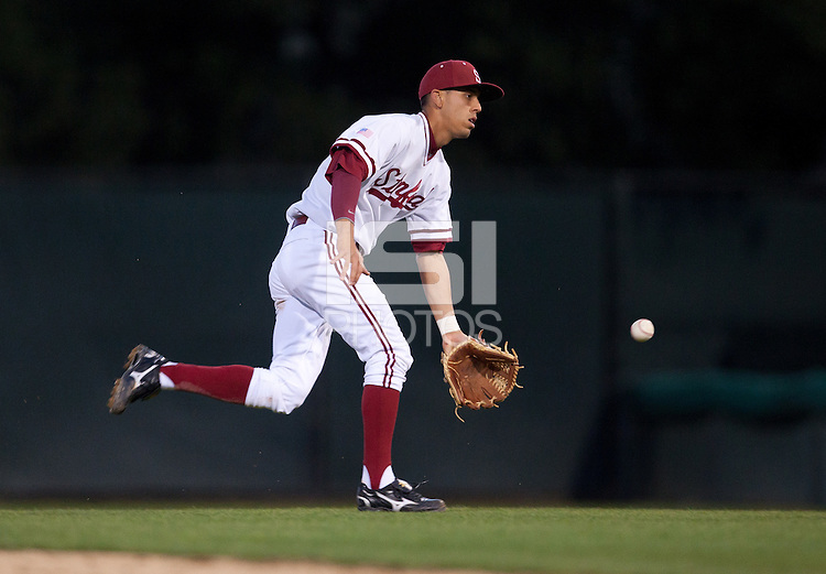 STANFORD, CA - February 23, 2011: Lonnie Kauppila of the Stanford baseball team flips the ball to the mound after an inning ending tag at second during Stanford's home opener against California at Sunken Diamond. Stanford won 3-2.