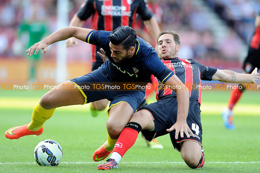 Graziano Pelle of Southampton is tackled by Dan Gosling of AFC Bournemouth - AFC Bournemouth vs Southampton - Pre-Season Friendly Football Match at the Goldsands Stadium, Kings Park, Boscombe, Bournemouth, Dorset - 25/07/14 - MANDATORY CREDIT: Denis Murphy/TGSPHOTO - Self billing applies where appropriate - contact@tgsphoto.co.uk - NO UNPAID USE