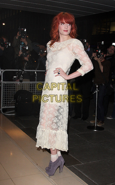FLORENCE WELCH (FLORENCE AND THE MACHINE).'An evening at the Sanderson' celebrating 10 years, at the Sanderson Hotel, London, England, .UK, April 27th 2010..full length sheer see thru through dress long hands on hips white lace cream grey gray suede ankle boots socks side .CAP/ROS.©Steve Ross/Capital Pictures