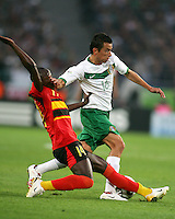 Mario Mendez (16) of Mexico avoids a sliding tackle from Mendonca (14) of Angola. Mexico and Angola played to a 0-0 tie in their FIFA World Cup Group D match at FIFA World Cup Stadium, Hanover, Germany, June 16, 2006.