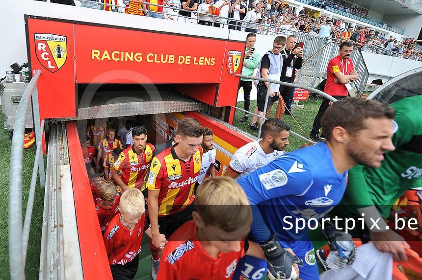 20190803 - LENS , FRANCE : illustration picture shows players entering the pitch with Jean Louis Leca (R) and Clement Michelin (M) pictured during the soccer match between Racing Club de LENS and En Avant Guingamp , on the second matchday in the French Dominos pizza Ligue 2 at the Stade Bollaert Delelis stadium , Lens . Saturday 3 th August 2019 . PHOTO DIRK VUYLSTEKE | SPORTPIX.BE