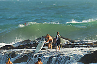 Snapper Rocks, Coolangatta, Queensland (Friday January 14, 2011)  A surfer attempting to jump off the rocks at Snapper Rocks is caught by a breaking wave. The rocks are very sharp on this out crop and can cause some serious damage but this time around it was just a case of hurt pride.  .An East swell  in the 4-6ft range  on the open beaches but it was a bit bumpy this morning. The water was still a bit dirty from all the rain and the winds were light SSW. The southerly points were the only spots handling the solid swell. There were some fun, smaller waves from Snapper to Coolangatta, but very crowded.  Photo: joliphotos.com