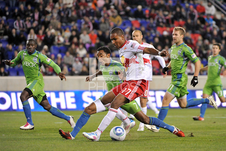 Juan Agudelo (17) of the New York Red Bulls is defended by James Riley (7) of the Seattle Sounders. The New York Red Bulls defeated the Seattle Sounders 1-0 during a Major League Soccer (MLS) match at Red Bull Arena in Harrison, NJ, on March 19, 2011.