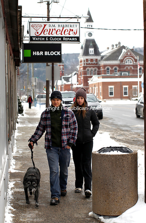Thomaston, CT- 05 January 2014-010514CM01-  Jon and Megan Zaleski of Thomaston walk  their dog Gimli, along Main Street in Thomaston on Sunday.  According to the National Weather Service, Monday is expected to see temperatures rise to near 48 by 9 a.m., then fall to around 31 during the remainder of the day.  Christopher Massa Republican-American