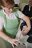 Nurse applying a scotch cast diabetic boot to patient's foot for pressure relief in outpatients plaster room,