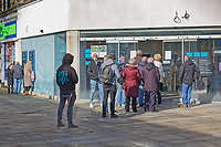 Pictured: A queue of people outside Barclays Bank in the city centre of Swansea, south Wales, UK. Friday 20 March 2020<br /> Re: Covid-19 Coronavirus pandemic, UK.