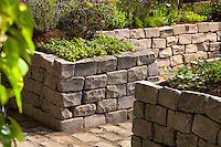 "Cobblestone rock walls, raised beds in ""Days Gone By"" edible garden exhibit by Hortisculpture Landscape Design at San Francisco Flower & Garden Show 2014"