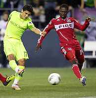 Chicago Fire forward Patrick Nyarko, right, defends a shot by Seattle Sounders FC forward Fredy Monter during play between the Seattle Sounders FC and the Chicago Fire in the U.S. Open Cup Final at CenturyLink Field in Seattle Tuesday October 4, 2011. Seattle won the game 2-0 to win its third U.S. Open Cup.