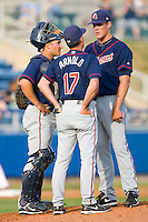 Kinston Indians pitching coach Tony Arnold #17 has a chat with starting pitcher Nick Hagadone #35 and catcher Doug Pickens #20 at Lewis-Gale Field May 1, 2010, in Winston-Salem, North Carolina.  Photo by Brian Westerholt / Four Seam Images
