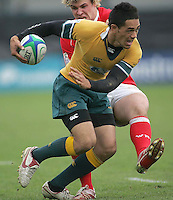 Australia winger Alfi Mafi is tackled by Welsh centre Rhys Williams during the clash 3rd/4th place clash at Ravenhill, Belfast.