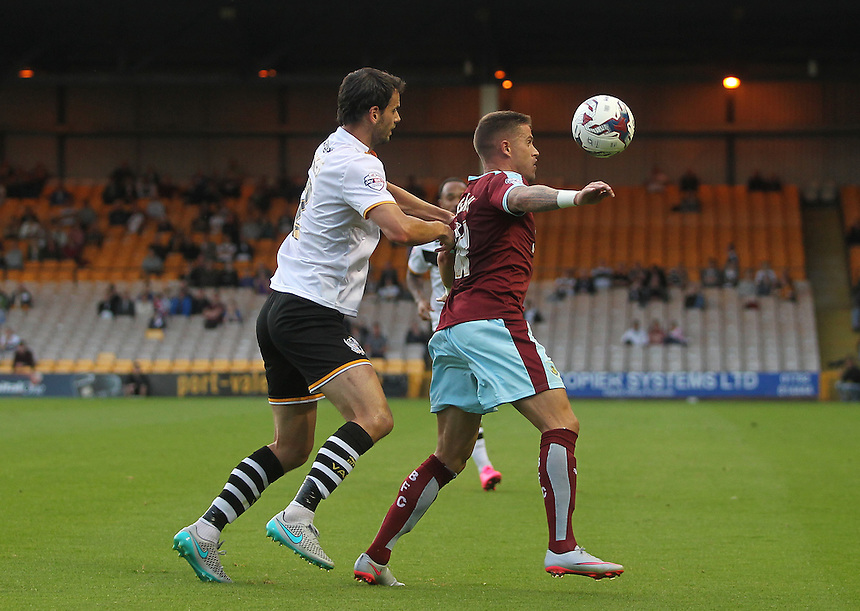 Burnley's Michael Kightly battles with  Port Vale's Ben Purkiss<br /><br />Photographer Mick Walker/CameraSport<br /><br />Football - Capital One Cup First Round - Port Vale v Burnley - Tuesday 11th August 2015 - Vale Park - Burslem<br /> <br />&copy; CameraSport - 43 Linden Ave. Countesthorpe. Leicester. England. LE8 5PG - Tel: +44 (0) 116 277 4147 - admin@camerasport.com - www.camerasport.com