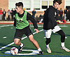 Luis Tinoco, a 2017 graduate of Mineola High School, left, and current sophomore Christopher Morandi battle for possession during a soccer game in honor of late senior Christian Melendez at Mineola High School on on Thursday, Jan. 3, 2019. Melendez, a senior and a captain of the varsity team, died after an automobile accident in which he was a passenger on Dec. 21, 2018. He was laid to rest today on what would have been his 19th birthday. Morandi scored the game's lone goal.