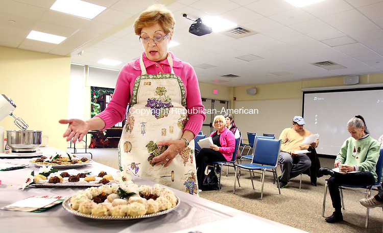 MIDDLEBURY CT. 01 DECEMBER 2015-120215SV04-Marie Noujaim Harb demonstrates how to make traditional holiday cookies from around the world during The Home for the Holidays demonstration at he library in Middlebury Wednesday. <br /> Steven Valenti Republican-American