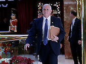 United States Vice President-elect Mike Pence walks through the lobby of Trump Tower on November 29, 2016 in New York City.     <br /> Credit: John Angelillo / Pool via CNP