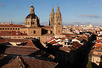 "Rooftop view of Clerecia Church, Salamanca, Spain, pictured on December 19, 2010 in the afternoon, from the New Cathedral. The Baroque style Clerecia Church, originally the Royal College of the Company of Jesus, was commissioned in the 17th century, from architect Juan Gomez de Mora, by Queen Margarita of Austria, wife of Philip III of Spain. It comprises two sections: the Jesuit school and church, with its three-storey Baroque cloister, and private living quarters for the monks and now houses the Salamanca Pontificia University.  Salamanca, an important Spanish University city, is known as La Ciudad Dorada (""The golden city"") because of the unique golden colour of its Renaissance sandstone buildings. Founded in 1218 its University is still one of the most important in Spain. Around it the Old Town is a UNESCO World Heritage Site. Picture by Manuel Cohen"