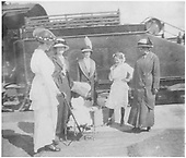 Group of four ladies in early 20th century clothing and two children standings by a locomotive.<br /> D&amp;RG