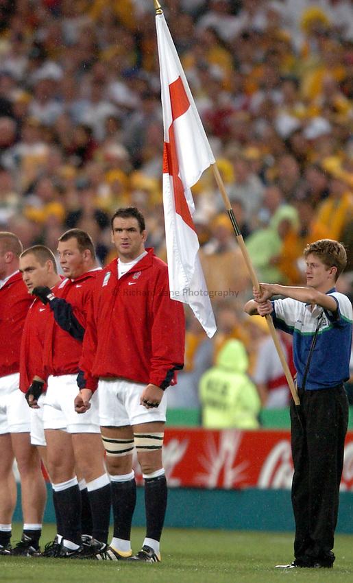 Photo: Richard Lane..Australia v England. Rugby World Cup Final, at the Telstra Stadium, Sydney. RWC 2003. 22/11/2003. .Martin Johnson lines up next to the St. George's Flag.