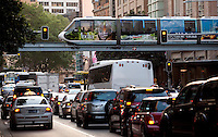 14 SEP 2009 - SYDNEY, AUS - One of Sydney's monorail trains passes over the evening rush hour traffic (PHOTO (C) NIGEL FARROW)