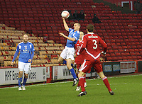 Tom Brighton jumps to head the ball in the Aberdeen v Queen of the South William Hill Scottish Cup 5th Round match played at Pittodrie Stadium, Aberdeen on 4.2.12.