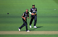 Jeetan and Samit Patel celebrate a wicket during the Burger King Super Smash Twenty20 cricket match between the Wellington Firebirds and Northern Knights at the Hawkins Basin Reserve in Wellington, New Zealand on Wednesday, 20 December 2017. Photo: Dave Lintott / lintottphoto.co.nz
