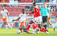 Blackpool's Viv Solomon-Otabor is tackled by Rotherham United's Will Vaulks and Josh Emmanuel<br /> <br /> Photographer Alex Dodd/CameraSport<br /> <br /> The EFL Sky Bet League One - Rotherham United v Blackpool - Saturday 5th May 2018 - New York Stadium - Rotherham<br /> <br /> World Copyright &copy; 2018 CameraSport. All rights reserved. 43 Linden Ave. Countesthorpe. Leicester. England. LE8 5PG - Tel: +44 (0) 116 277 4147 - admin@camerasport.com - www.camerasport.com