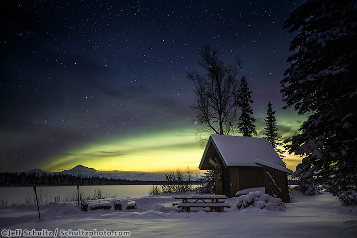 Winter landscape of Denali (Mt. Mckinley) and Northern Lights (Aurora Borealis) in sky with cabin at North Country Bed and Breakfast during a Private custom winter night-sky and landscape photography tour with Ariel and Chinese group of 8 colledge students.  Fairbanks, Trapper Creek, Sheep Mountain  December 17-24 2016<br /> <br /> Photo by Jeff Schultz/SchultzPhoto.com  (C) 2016  ALL RIGHTS RESVERVED