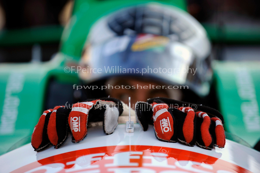 The gloves of Michel Jourdain, Jr. (#30) drape over the windscreen of his car.