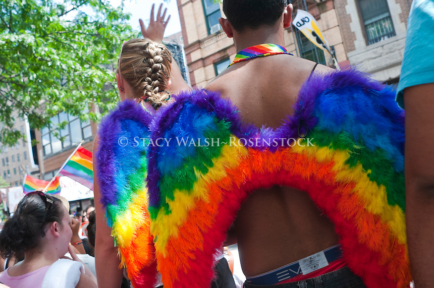 New York, NY -  24 June 2012 Spectators on Christopher Street wearing rainbow colored wings at the Lesbian and Gay Pride Parade.