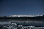 Winter night view of the Cairngorms across Loch Morlich, Highlands, Scotland