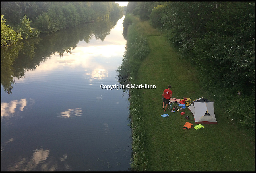 BNPS.co.uk (01202 558833)<br /> Pic: MatHilton/BNPS<br /> <br /> Camping on the L'Oise canal bank.<br /> <br /> An adventurous husband and wife have completed a grueling 870 mile journey to the Mediterranean in a homemade wooden boat. <br /> <br /> Mat and Polly Hilton traveled from England all the way to the South of France in a tiny 13ft sailboat to raise money for charity. <br /> <br /> The epic voyage took the intrepid duo 56 days to complete and exhaustingly they were forced to row almost the entire way due to poor sailing conditions.