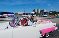 Havana Cuba tourists in classic 50s auto in Revolution Square relaxing on holiday   9