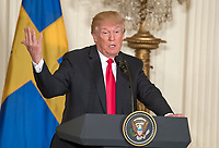 United States President Donald J. Trump answers questions as he and Prime Minister Stefan Lofven of Sweden hold a joint press conference in the East Room of the White House in Washington, DC on Tuesday, March 6, 2018.<br /> CAP/MPI/RS<br /> &copy;RS/MPI/Capital Pictures