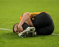 Wolverhampton Wanderers' Conor Coady lies on the ground after being injured<br /> Photographer Lee Parker/CameraSport<br /> <br /> The Premier League - Wolverhampton Wanderers v Newcastle United - Saturday 11th January 2020 - Molineux - Wolverhampton<br /> <br /> World Copyright © 2020 CameraSport. All rights reserved. 43 Linden Ave. Countesthorpe. Leicester. England. LE8 5PG - Tel: +44 (0) 116 277 4147 - admin@camerasport.com - www.camerasport.com